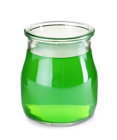 Tasty colorful jelly in glass jar on white background Stock Photo