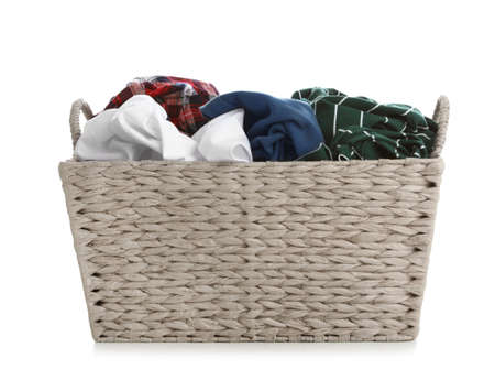 Wicker laundry basket full of dirty clothes on white background Imagens - 124961963