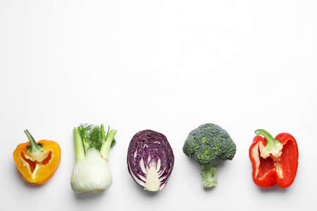Flat lay composition with fresh ripe vegetables on white background