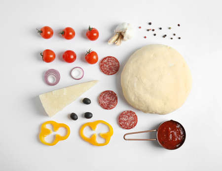 Flat lay composition with dough and ingredients for pizza on white background 스톡 콘텐츠