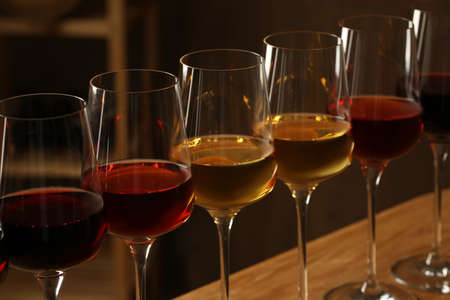 Glasses of different wines in cellar, closeup. Expensive collection Stockfoto