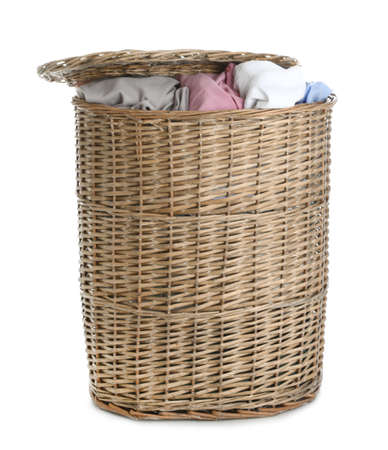 Wicker laundry basket full of dirty clothes on white background