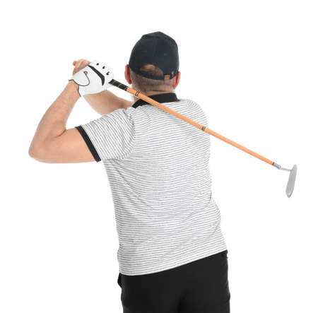 Senior man playing golf on white background