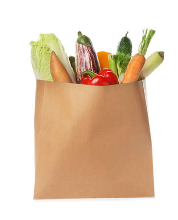 Paper bag with vegetables on white background Banco de Imagens