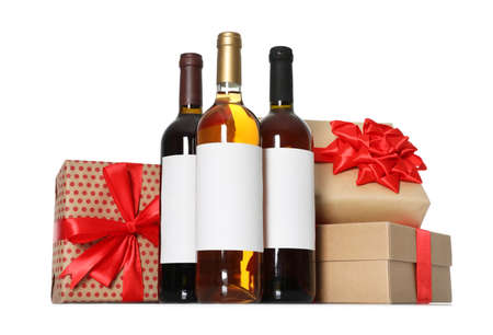 Bottles of wine and gift boxes on white background