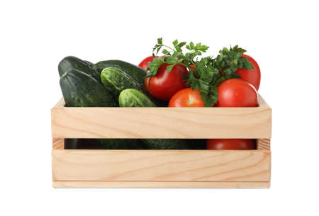 Wooden crate full of fresh vegetables on white background Banco de Imagens