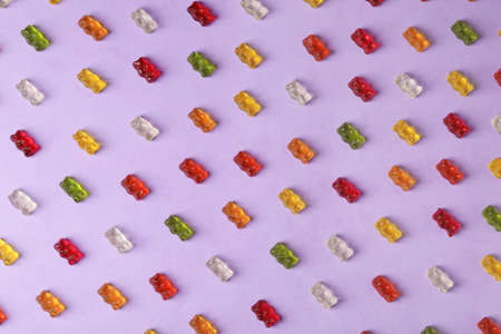 Flat lay composition with delicious jelly bears on color background