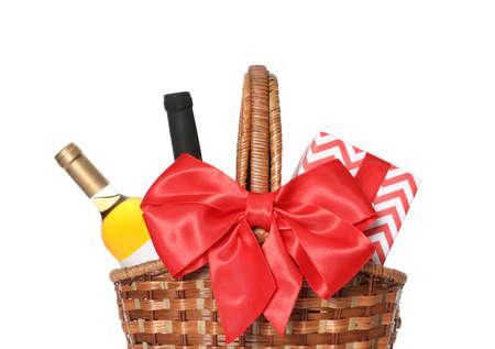 Festive basket with bottles of wine and gift on white background Reklamní fotografie