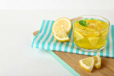 Glass of lemon jelly served on white table. Space for text Stock Photo