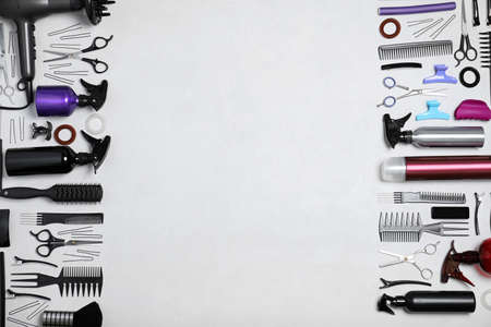 Set of professional hairdressers tools on light background, flat lay. Space for text