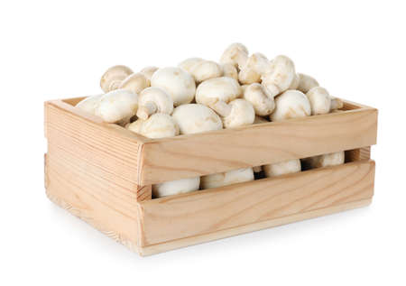 Wooden crate full of fresh raw mushrooms on white background 스톡 콘텐츠