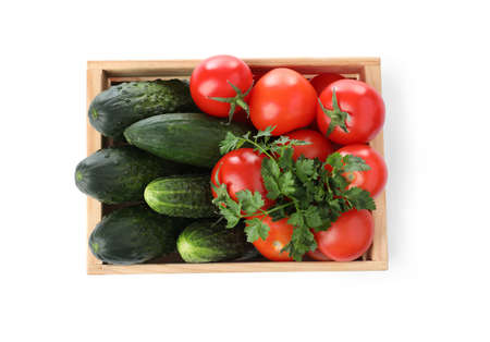 Wooden crate full of fresh vegetables on white background, top view Banco de Imagens