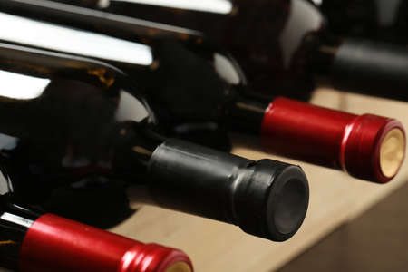 Bottles of different wines, closeup. Expensive collection