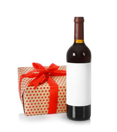 Bottle of wine and gift box on white background