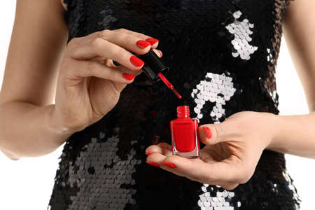 Woman holding nail polish brush and bottle, closeup 版權商用圖片
