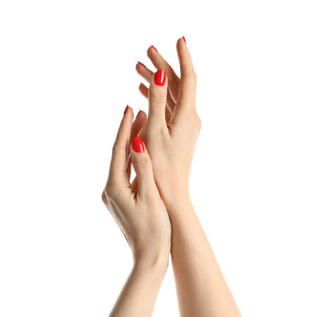 Woman showing manicured hands with red nail polish on white background
