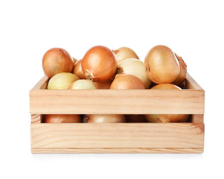 Wooden crate full of fresh onion bulbs on white background 写真素材 - 124979737