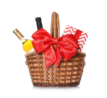 Festive basket with bottles of wine and gift on white background Stok Fotoğraf - 124979800