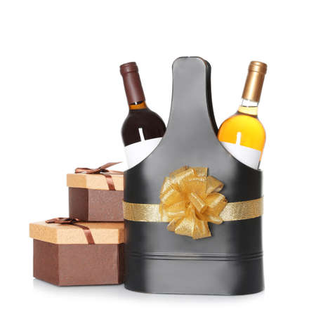 Festive package with bottles of wine and gift boxes on white background