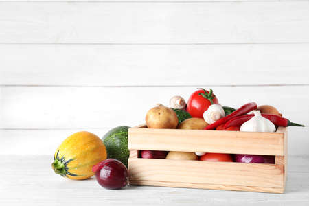 Wooden crate full of fresh vegetables on table. Space for text Stok Fotoğraf
