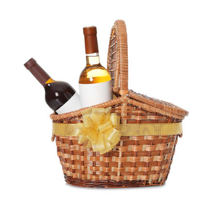Festive basket with bottles of wine on white background 스톡 콘텐츠