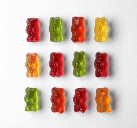 Delicious color jelly bears on white background, top view 写真素材