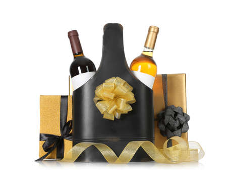 Festive package with bottles of wine and gift boxes on white background Stok Fotoğraf - 124988154