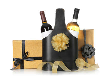 Festive package with bottles of wine and gift boxes on white background Stok Fotoğraf - 124988166