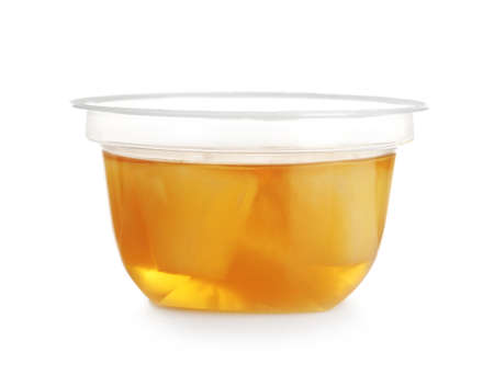 Plastic container with tasty pineapple jelly on white background