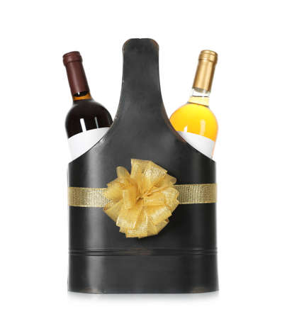 Festive package with bottles of wine on white background
