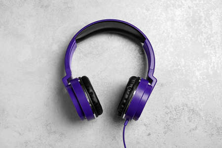 Stylish headphones on grey background, top view Stock Photo - 124989387