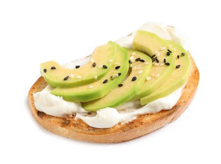 Tasty bruschetta with avocado and sesame seeds on white background Banco de Imagens