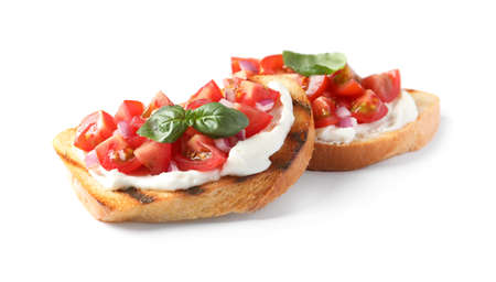 Tasty bruschettas with tomatoes on white background