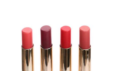 Many different stylish lipsticks on white background