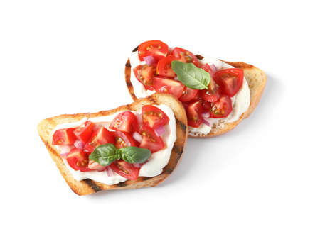 Tasty bruschettas with tomatoes on white background, top view