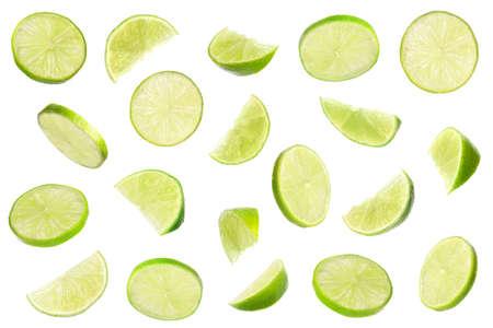 Set of flying cut fresh juicy lime on white background Stock Photo