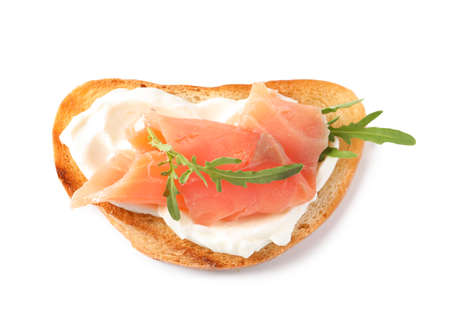 Tasty bruschetta with salmon and arugula on white background, top view