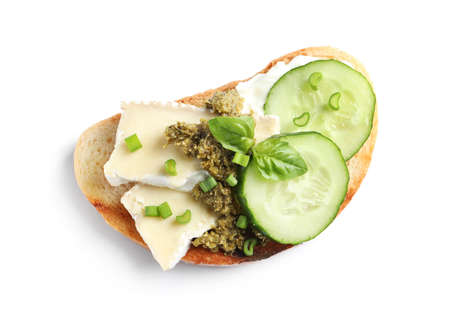 Tasty bruschetta with cucumber and cheese on white background, top view Banco de Imagens