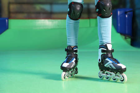 Person with roller skates at rink, closeup. Space for text Banco de Imagens