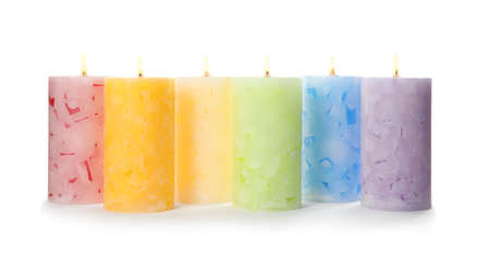 Alight color wax candles on white background