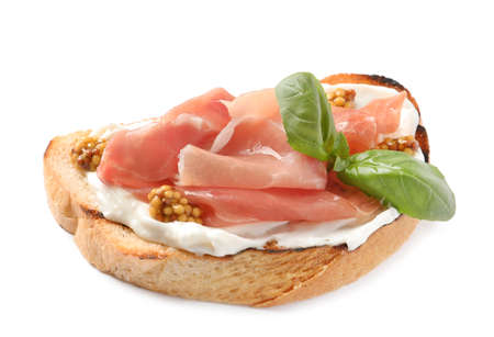 Tasty bruschetta with prosciutto and mustard on white background