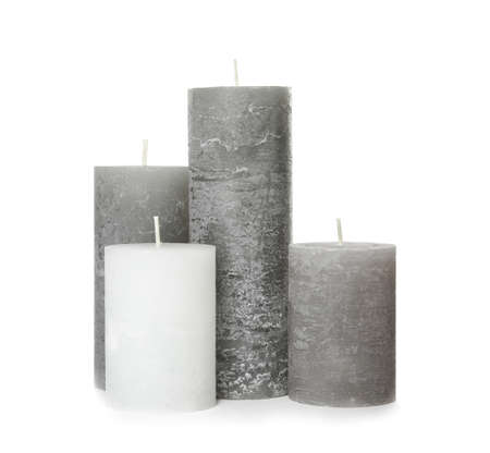 Many color wax candles on white background