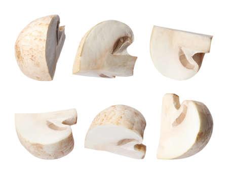 Set of flying cut fresh mushrooms on white background, closeup