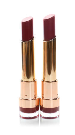 Two beautiful lipsticks on white background. Trendy makeup products Stok Fotoğraf - 124992718