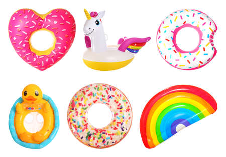 Set of bright inflatable rings and mattress on white background
