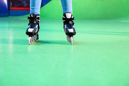 Person with roller skates at rink, closeup