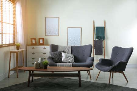 Contemporary living room interior with cozy sofa