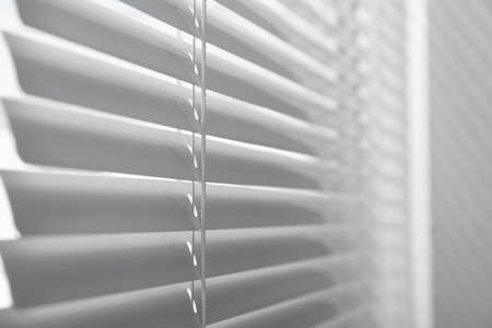 Closeup view of window with closed horizontal blinds Reklamní fotografie