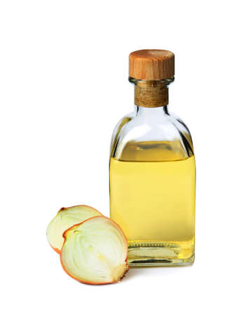 Glass bottle of onion syrup and fresh ingredient on white background