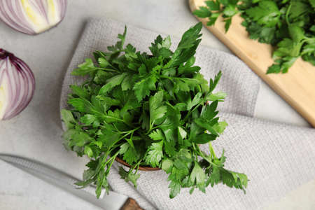 Flat lay composition with fresh green parsley on table